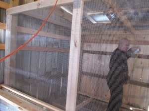 Johnny works on a snake-proof screen so the baby chicks will be safe.